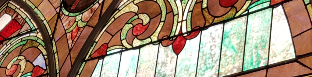 A photo showing a portion of a stained glass window.